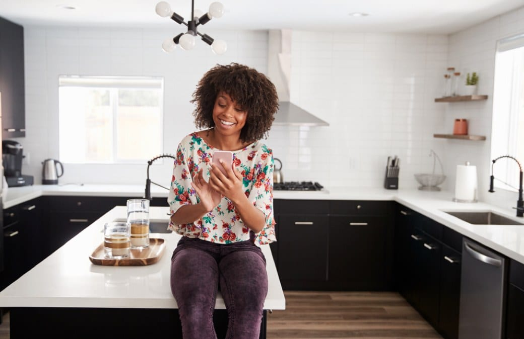 lady sitting atop a counter in a stylish kitchen